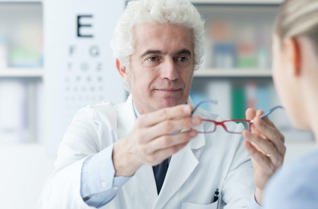 optician-giving-glasses-to-the-patient.jpg